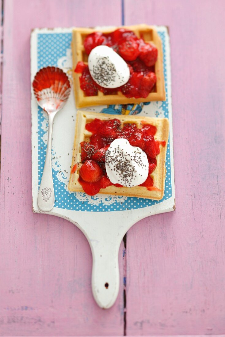 Waffles with strawberry jam, whipped cream and chia seeds