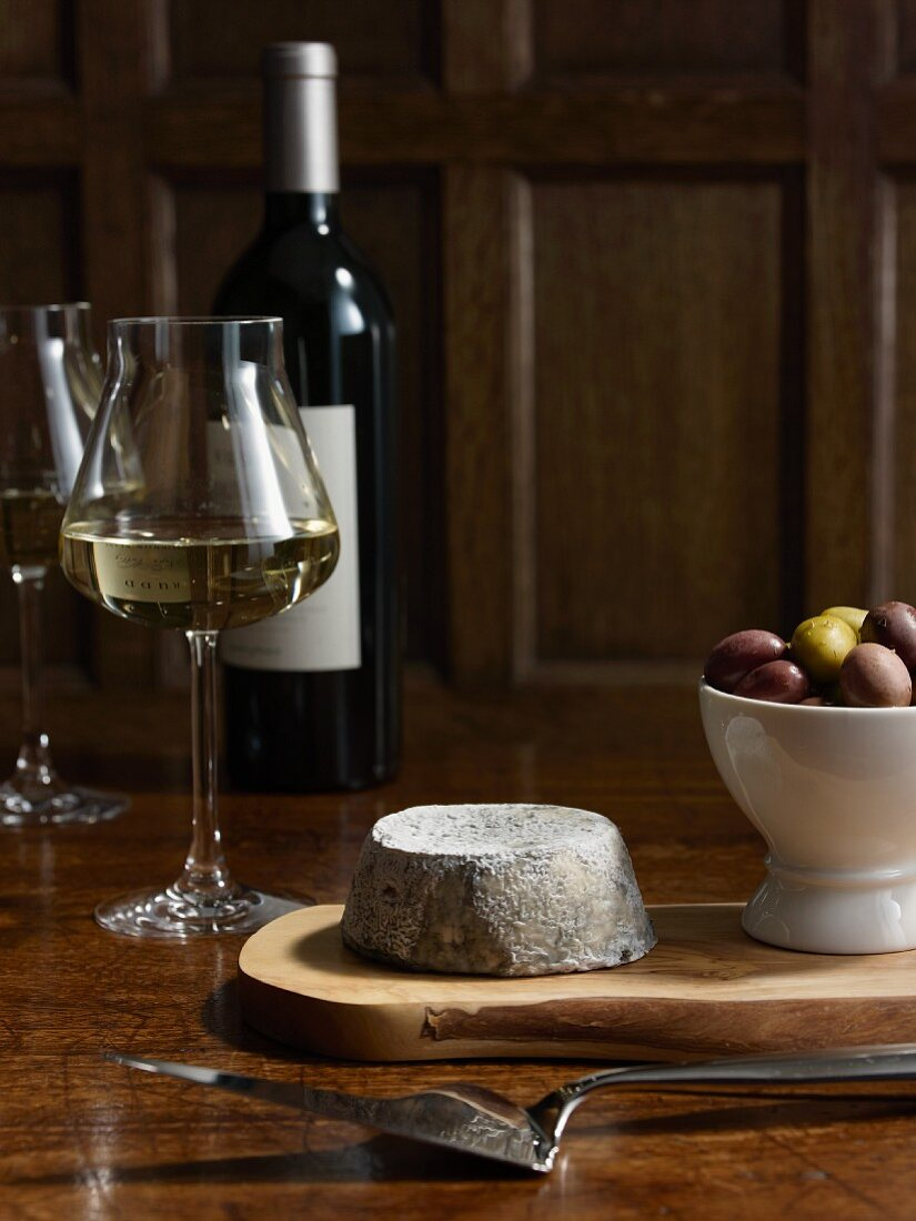 Cheese, olives and white wine