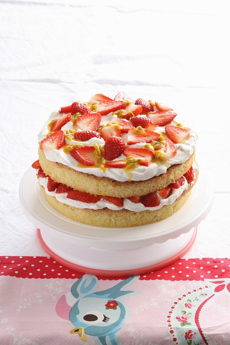 Lemon and almond sponge cake with strawberries and cream