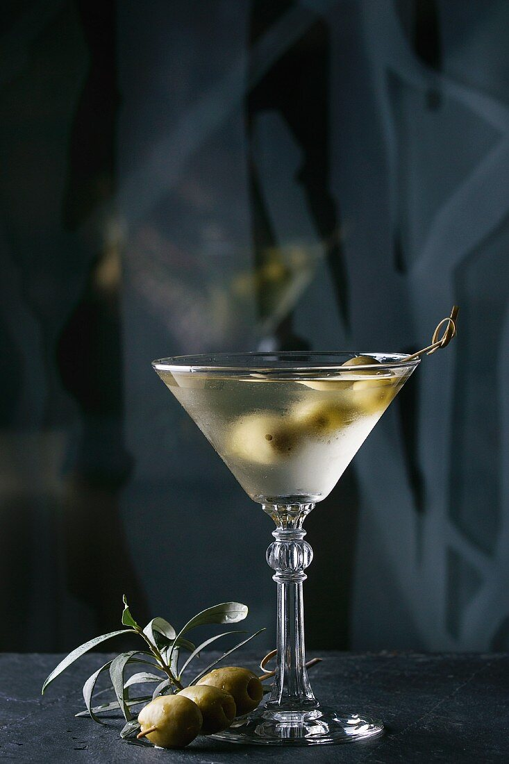 A martini vodka cocktail garnished with olives