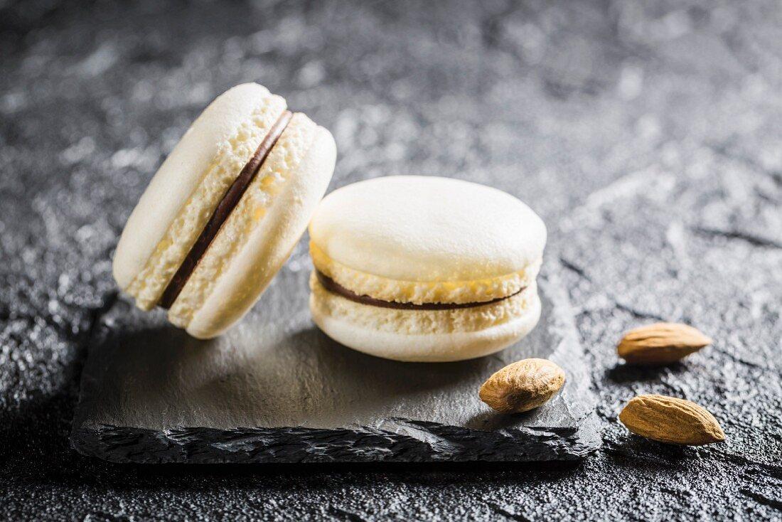 Almond macaroons on a black stone