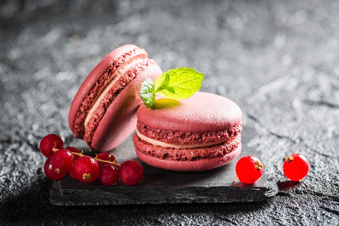 Redcurrant macaroons on a black stone