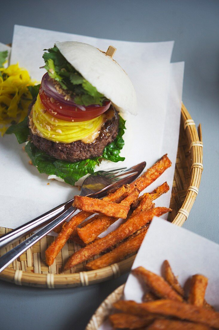 A beo burger with sweet potato fries at the restaurant Bun Bao, Berlin