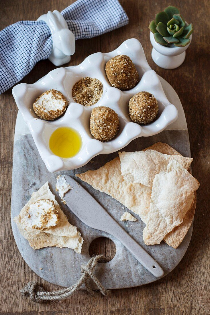 Labneh eggs in a dukkah coat (nut and spice mixture), with crispy flatbread