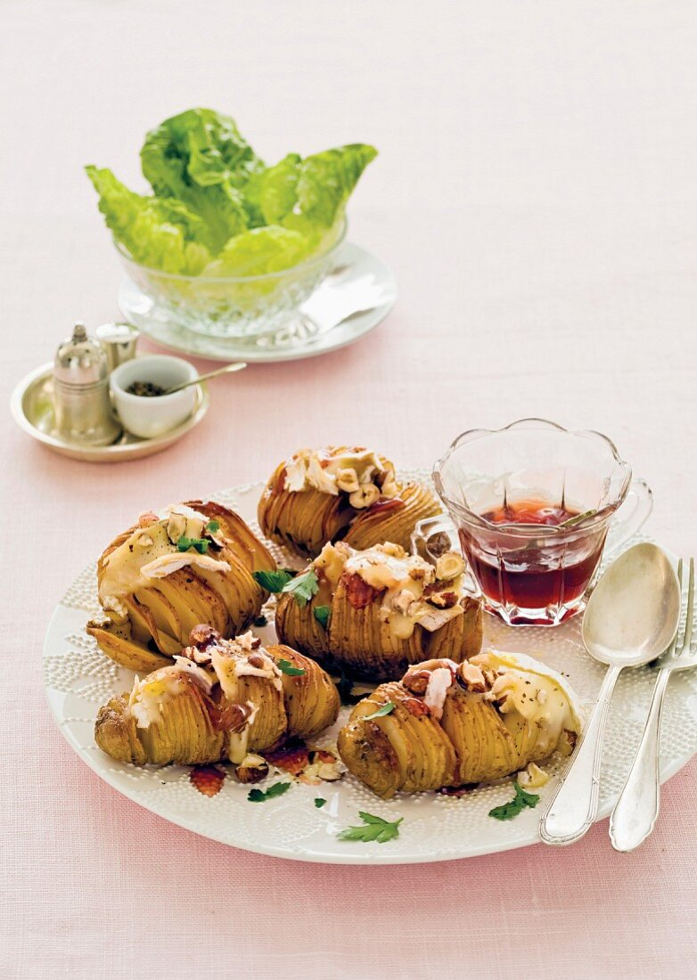 Hasselbeck potatoes topped with brie