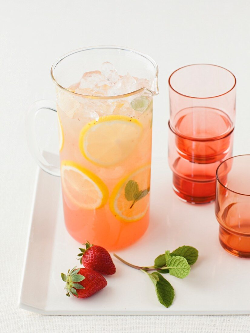 Strawberry lemonade in a glass jug