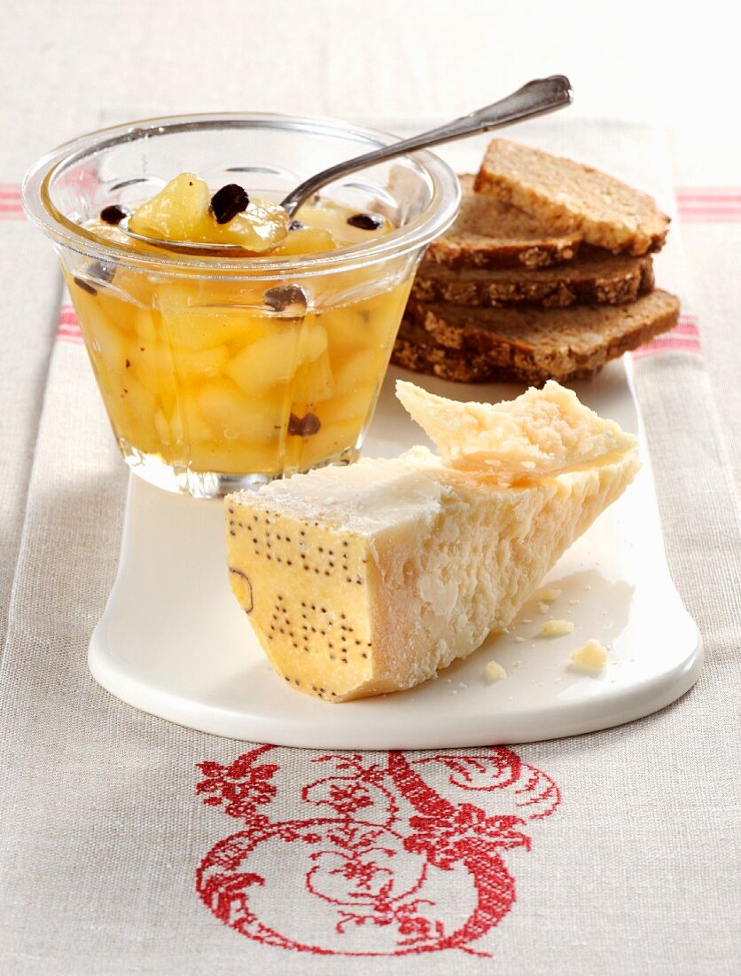 Pear compote with chocolate served with Parmesan cheese and bread