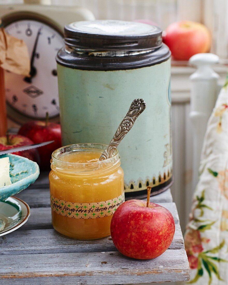 Apple, ginger and lemon jam in a glass jar