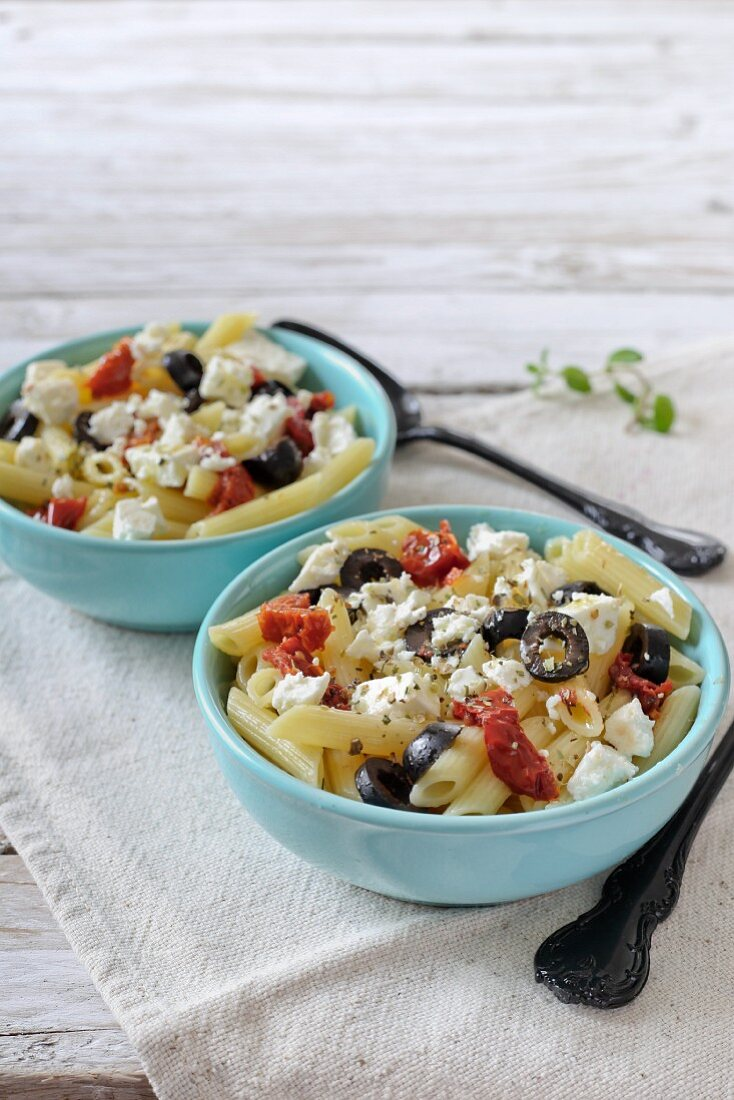 Pennette with dried tomatoes, feta cheese and black olives