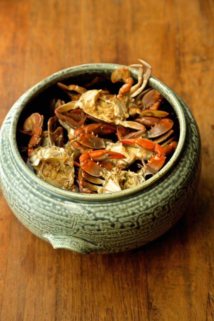 Soft shell crabs in a ceramic Korean pot