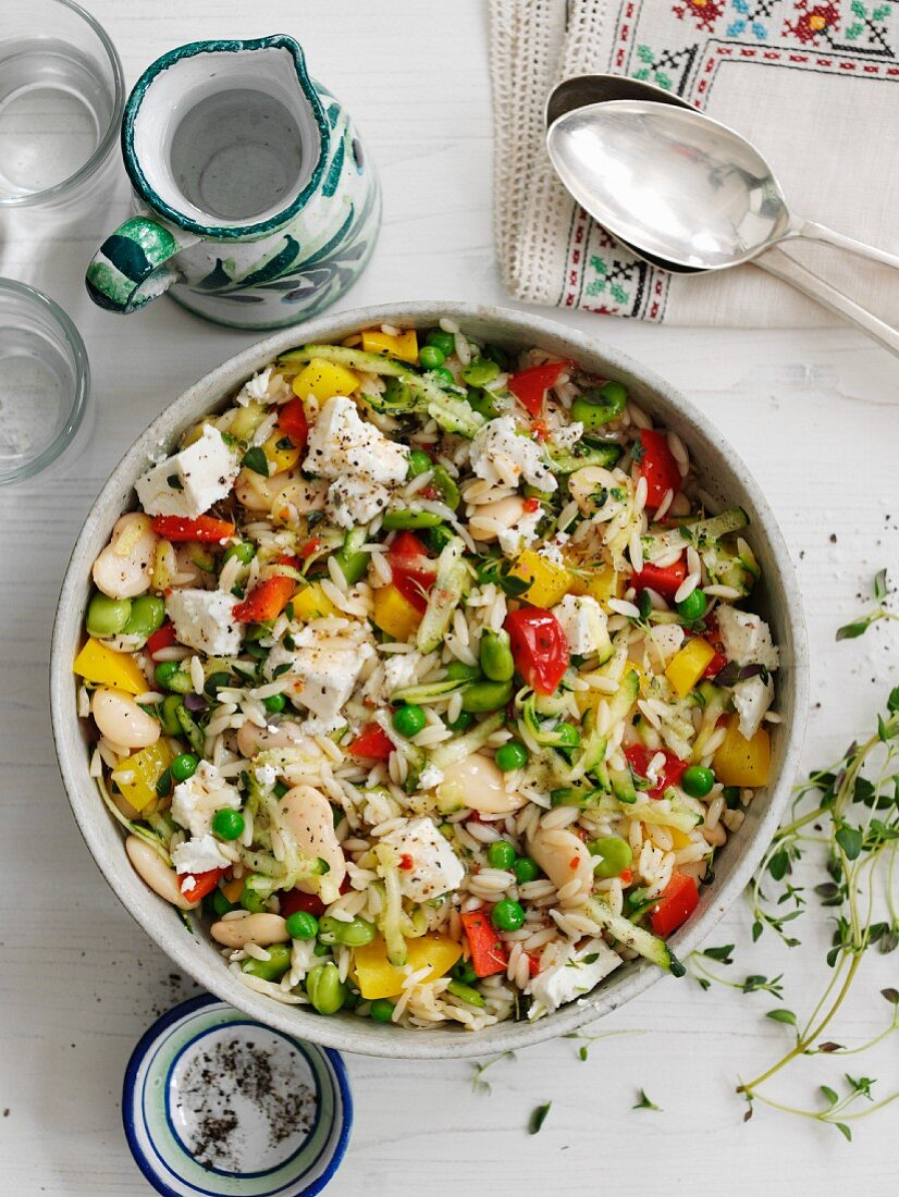Orzo salad with broad beans, peas and feta cheese