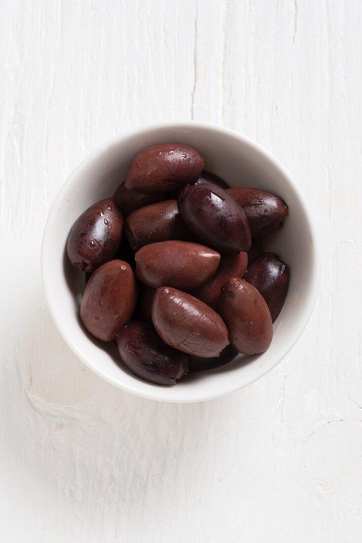 Kalamata olives in a white bowl