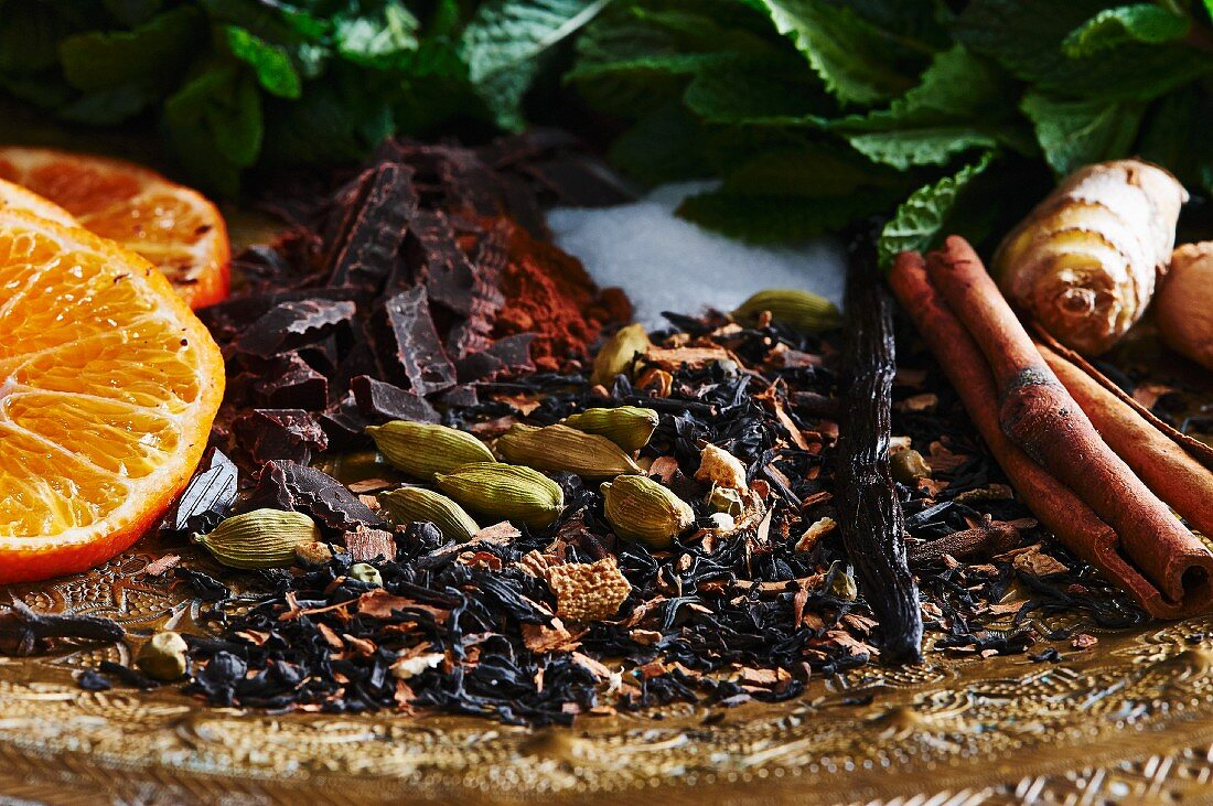 Various ingredients for hot drinks (oranges, spices and ginger)