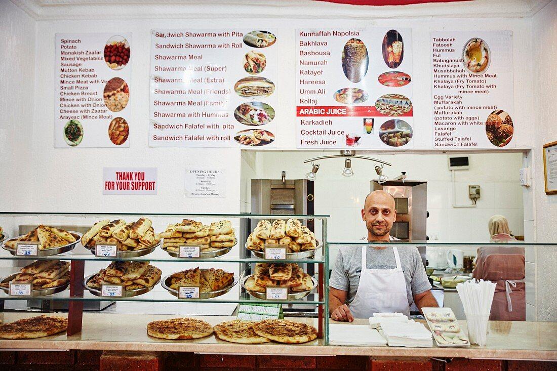 An Arab shop selling various snacks and unleavened bread
