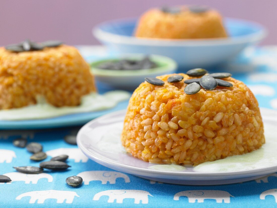 Rice and carrot domes on pea foam