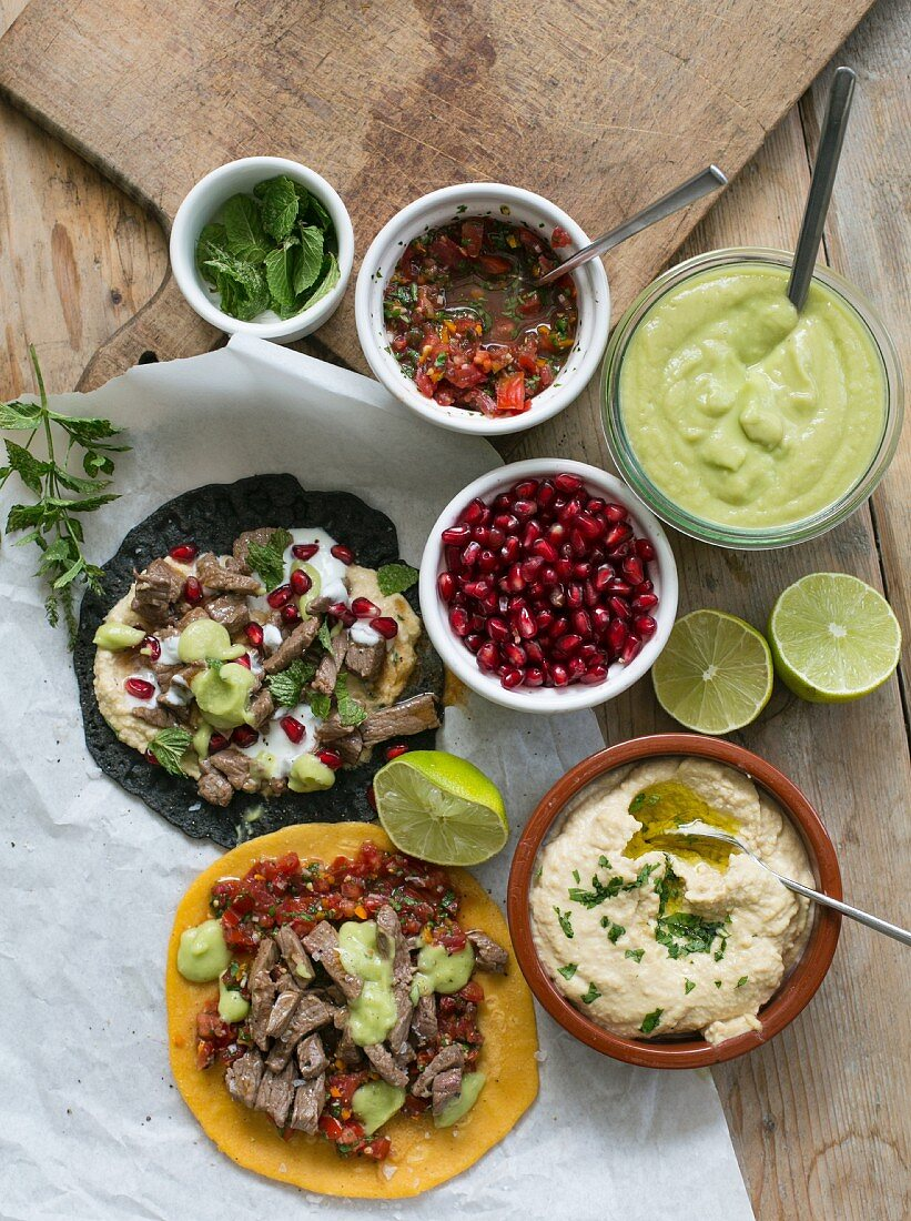Tacos with various toppings (seen from above)