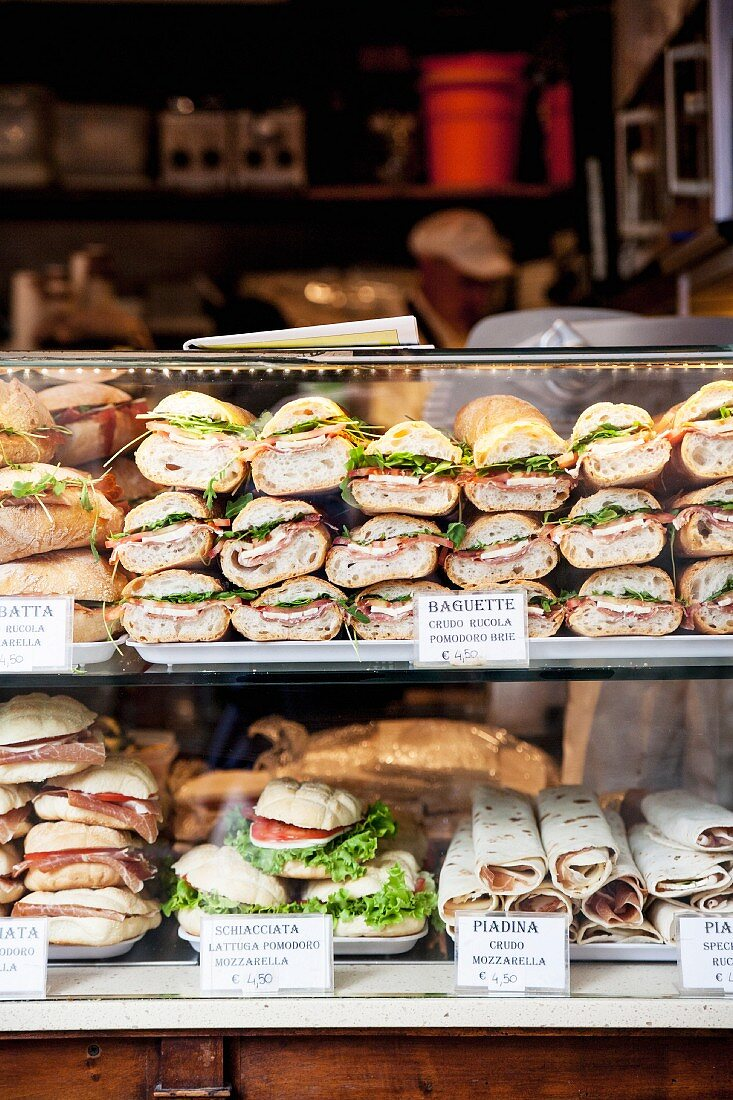 Various baguette sandwiches in a display cabinet