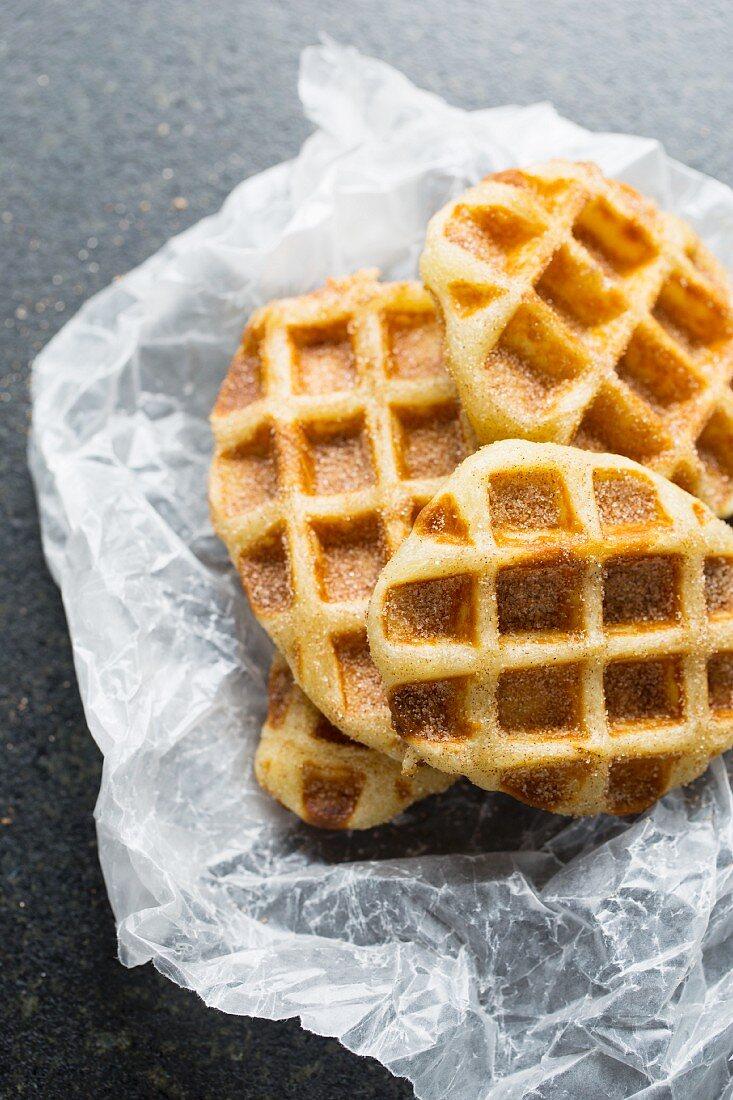 Churro waffles on greaseproof paper