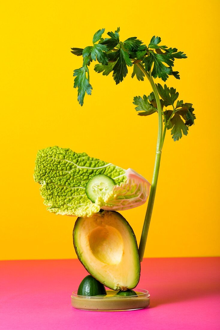 A vegetable sculpture against a coloured background