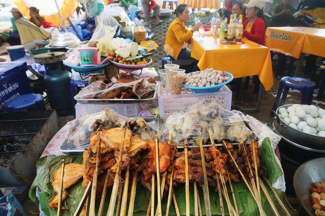Chicken kebabs in a street restaurant in Vientiane, Laos