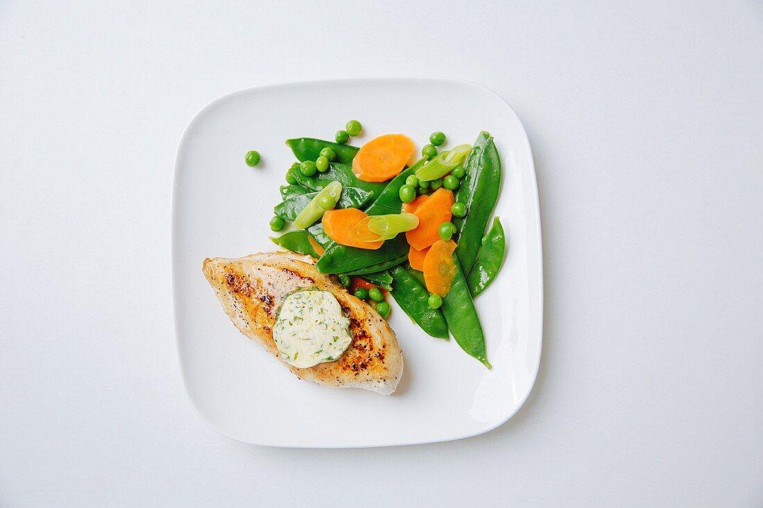 Chicken fillet with tarragon salt butter and spring vegetables