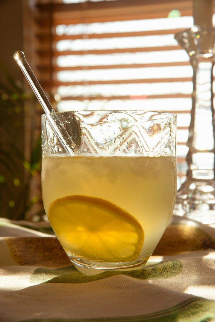 Limoncello cocktail with a slice of lemon