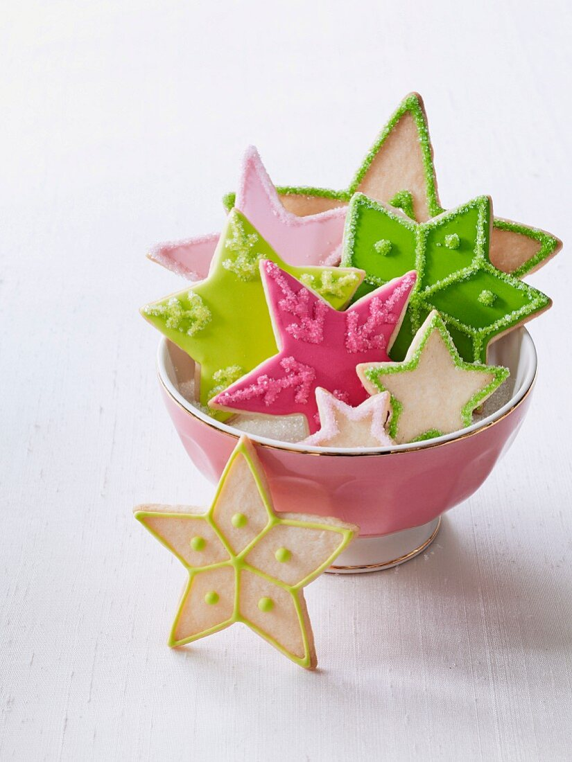 A bowl of colourful Christmas star biscuits