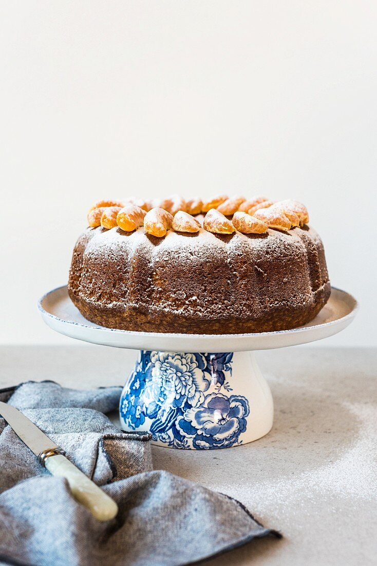 Olive oil Bundt cake with mandarin segments and icing sugar