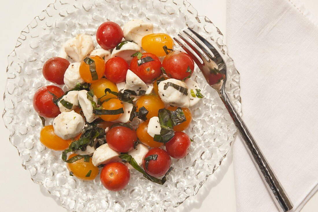 Grape tomato salad with mozzarella and basil (seen from above)