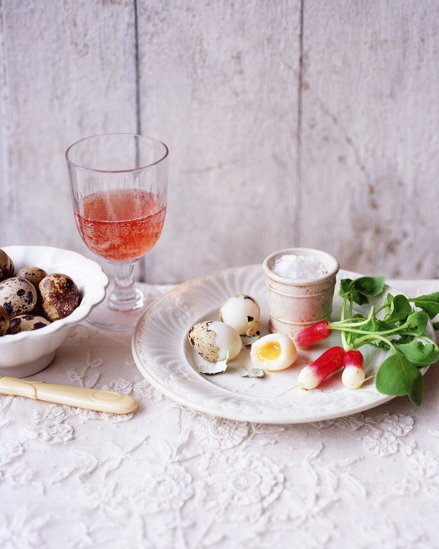 Boiled quail eggs with radishes