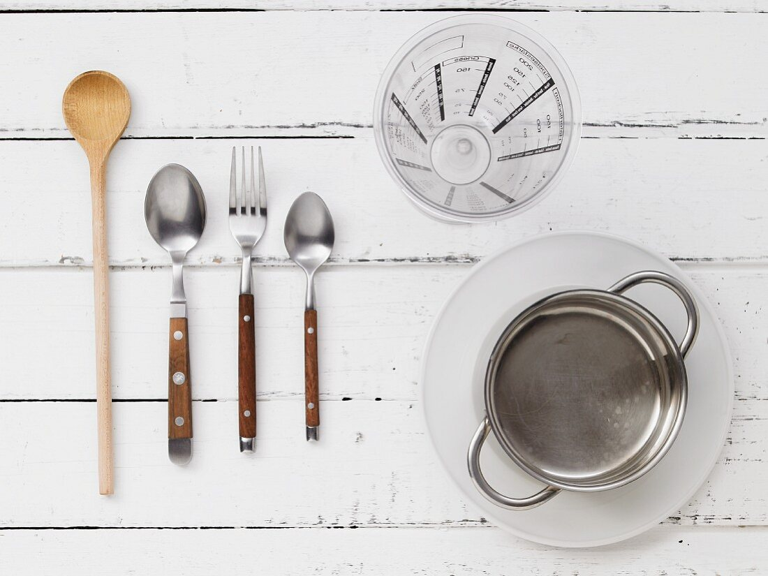 Kitchen utensils for creamed rice with banana and cocoa