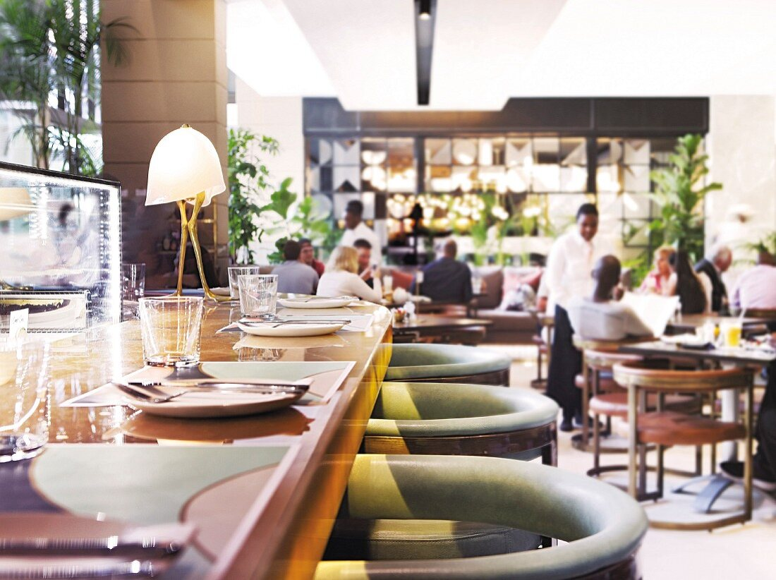 Guests and waiters at the restaurant Tashas in South Africa
