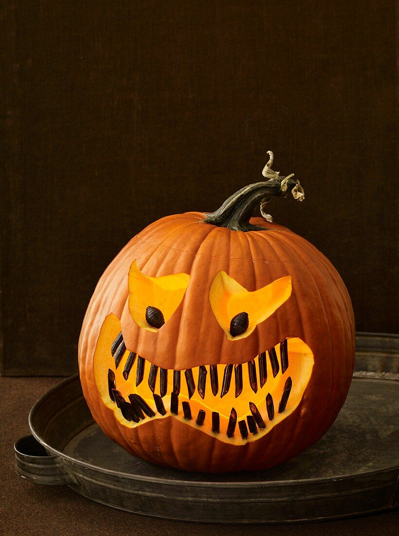 A Halloween pumpkin with a scary face