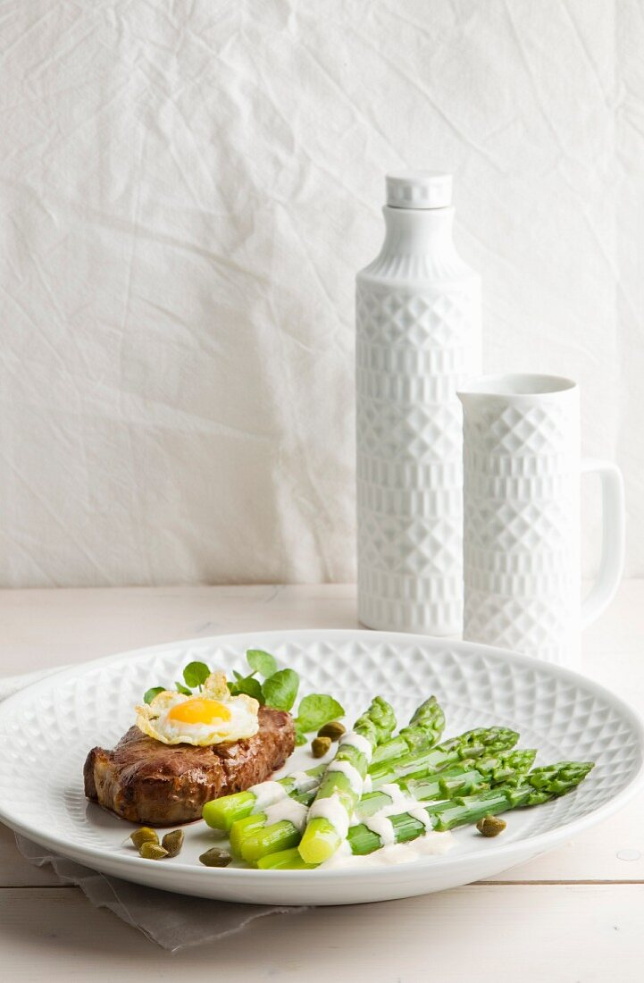 Green asparagus with tuna sauce, fillet mignon and a quail egg