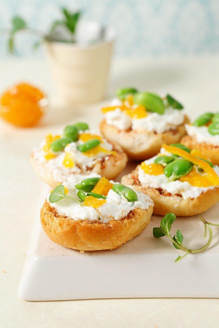 Bruschetta rolls with fresh cheese, orange jelly and fava beans