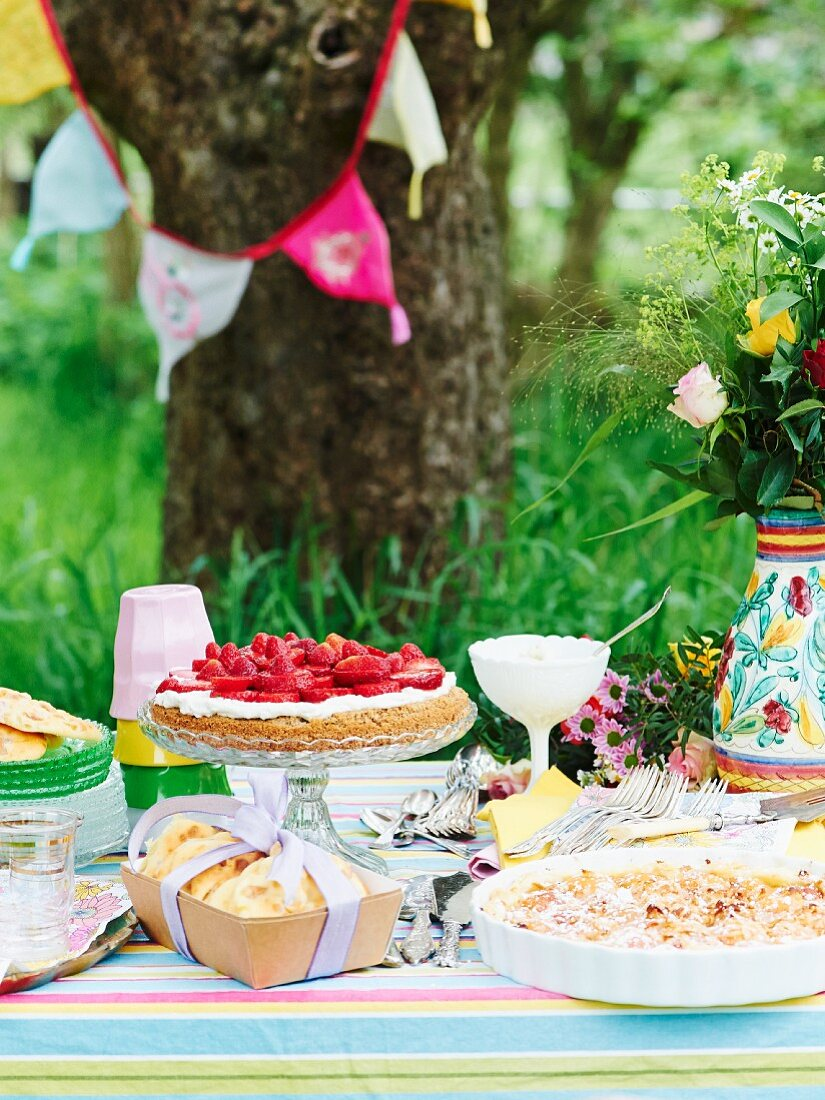 Various fruit cakes on garden table