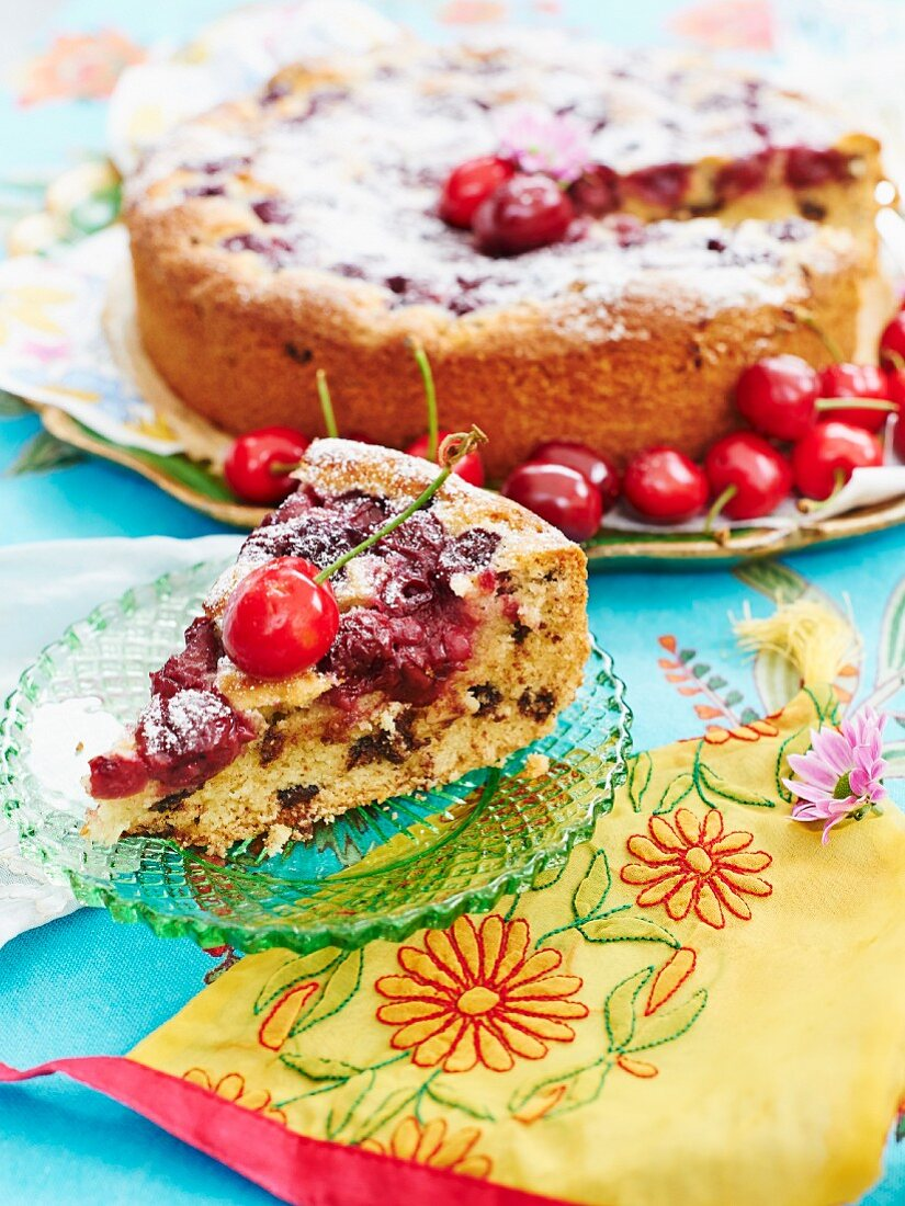 Cherry and chocolate cake dusted with icing sugar