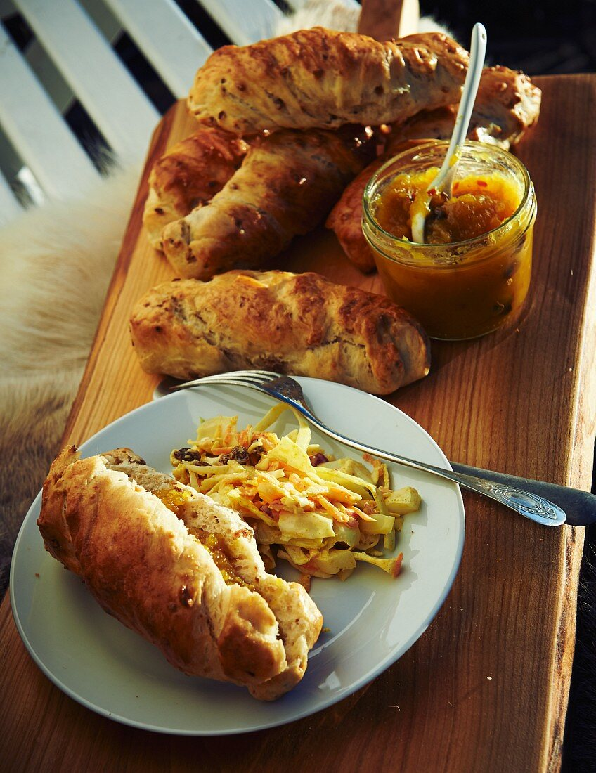 Hot dog buns with fried onions, coleslaw and apple chutney