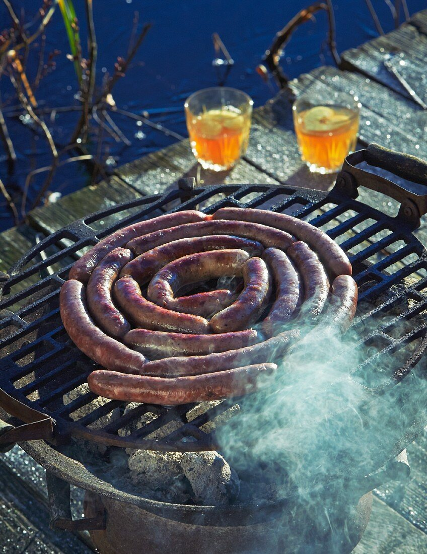 Wild boar sausages on a hot barbecue