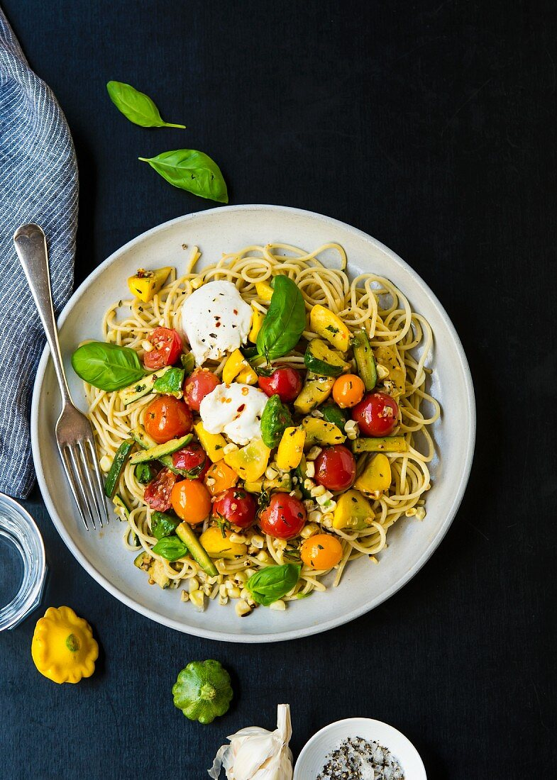 Spaghetti with anchovy paste, sautéed vegetables, burrata and basil