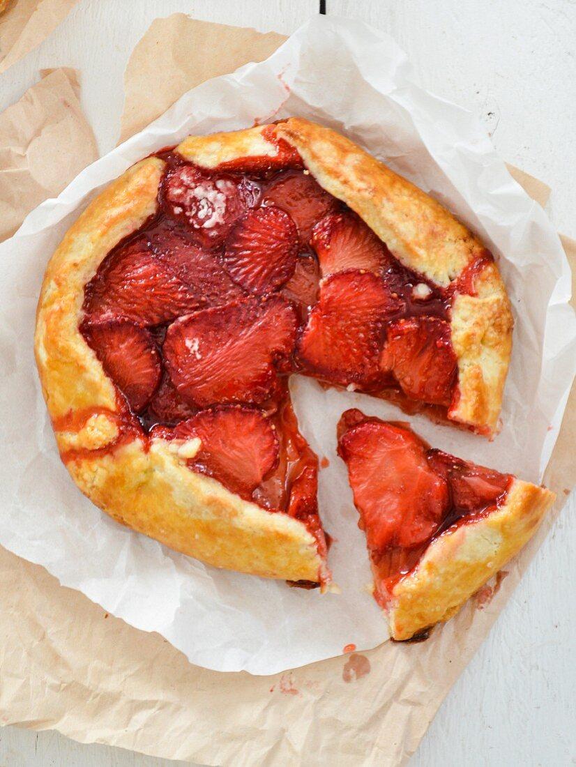 A sliced strawberry and balsamic vinegar tart
