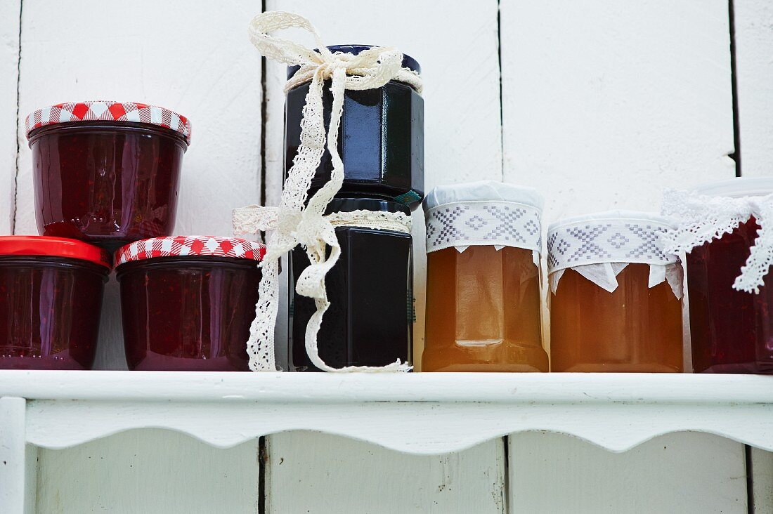 Various jam jars on a shelf