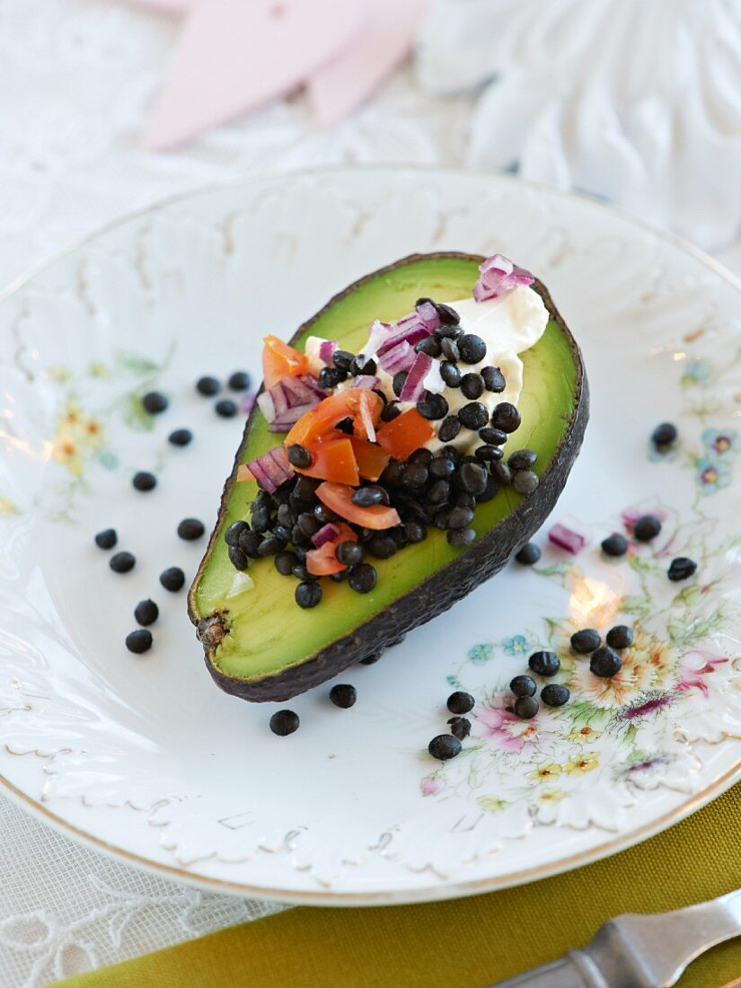 Avocado filled with lentils and red onion