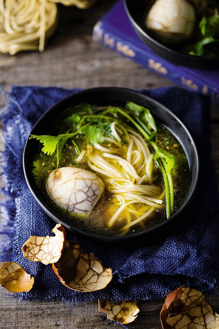 Marbled eggs with noodle soup (China)