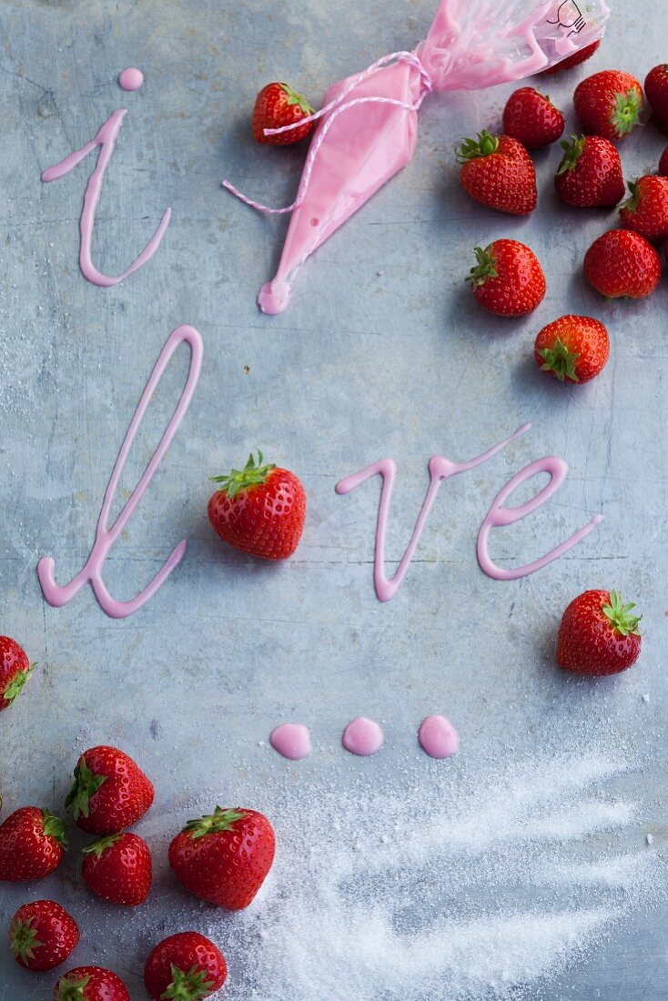 'I love you' written in pink icing