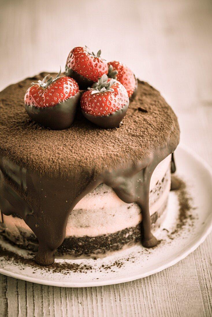 A mini chocolate cake with strawberries