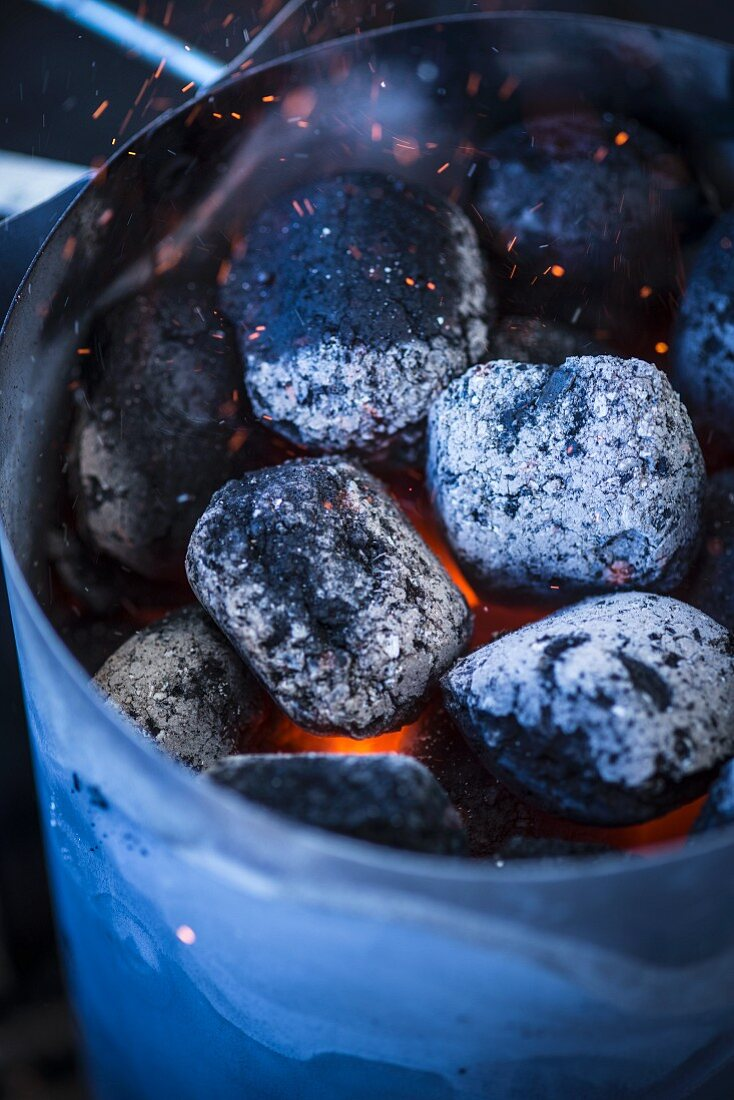 Briquettes in a chimney starter