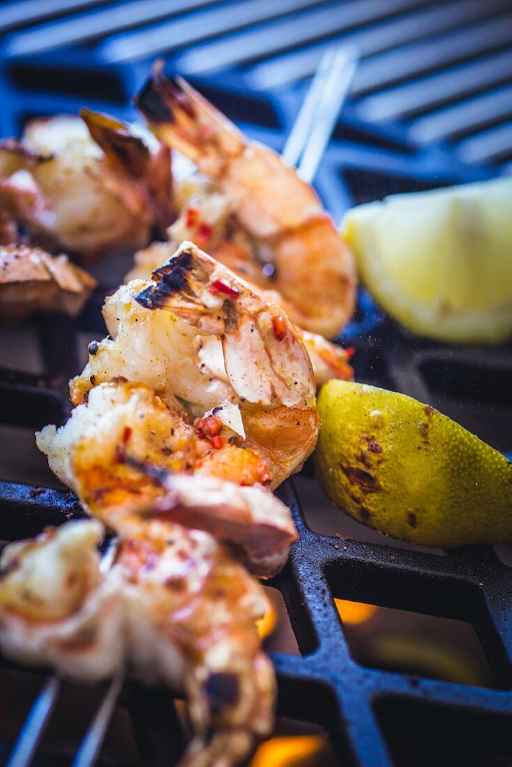 Grilled shrimps on the barbecue (close-up)