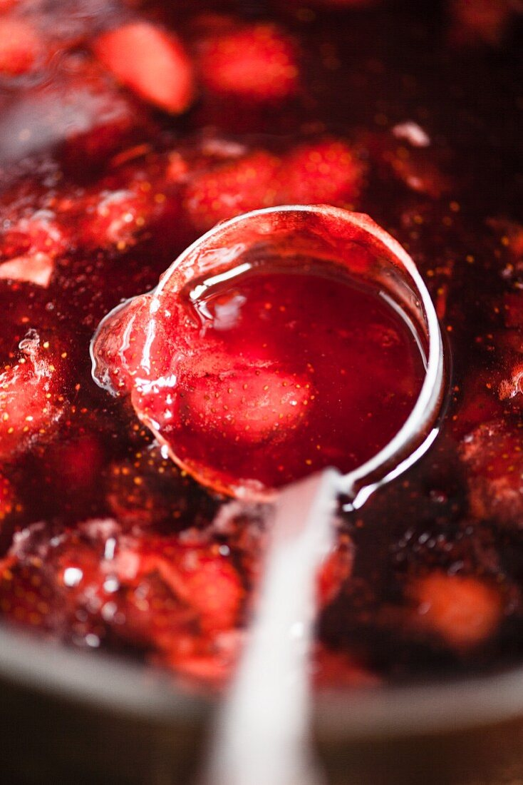 Strawberry jam on a ladle