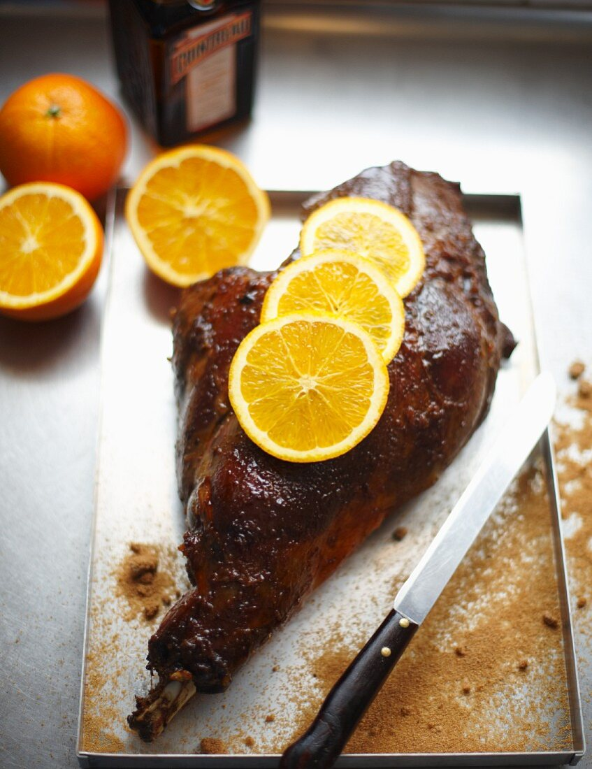 Leg of venison with Cointreau and orange slices
